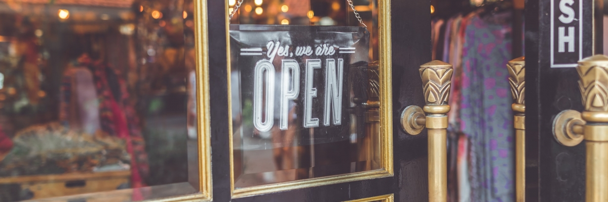 closeup-photo-black-door-yes-we-are-open-signage-929245